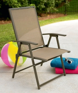 A glamour shot of my new chair. This is not my patio, nor my beach equipment. If only.