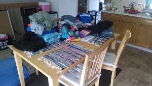 This was my kitchen table for a week. These are not my clothes.