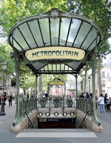 Abbesses Metro station entrance with original Art Nouveau architecture.